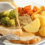 Pouring Gravy On A Roast Turkey Meal